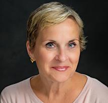 Profile photo of Rachel Wrenn, against a dark background